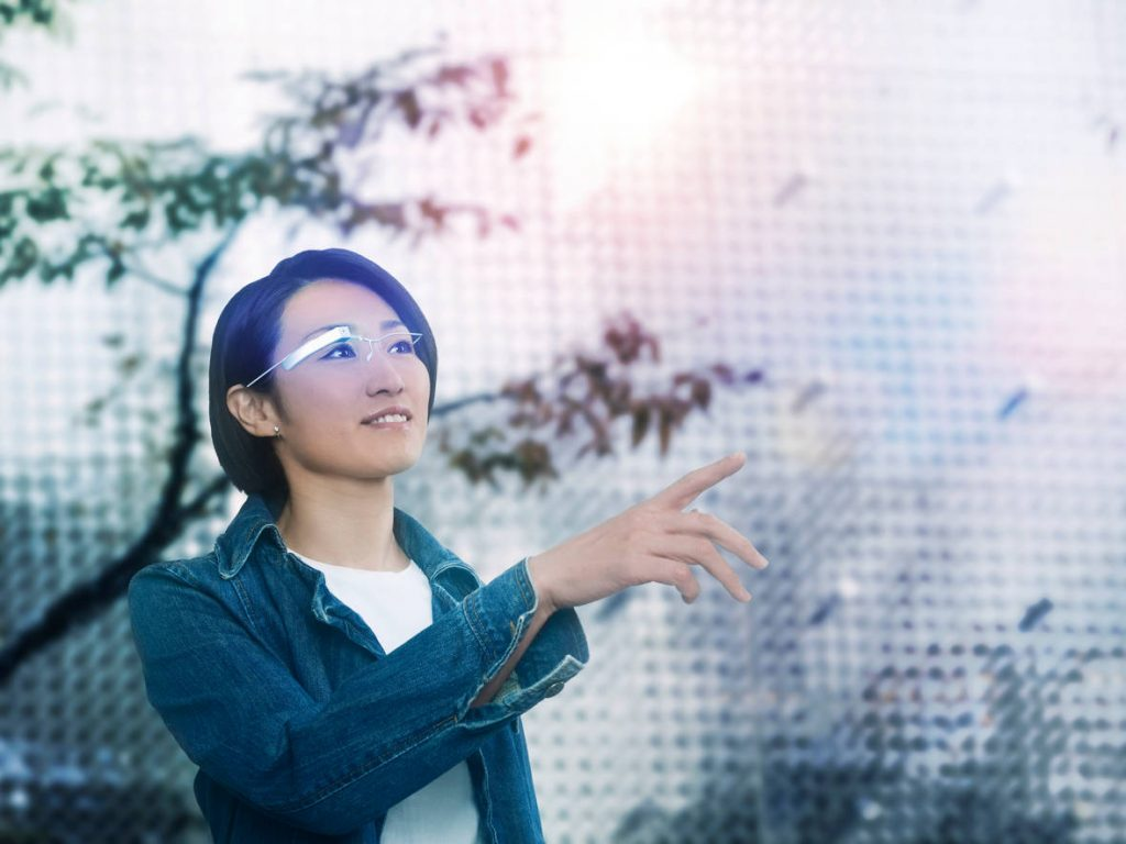 Start-up management in logistics - woman uses smart glasses