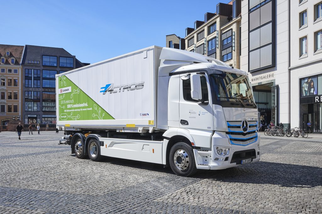 Electo truck is parking on the market place of Leipzig.