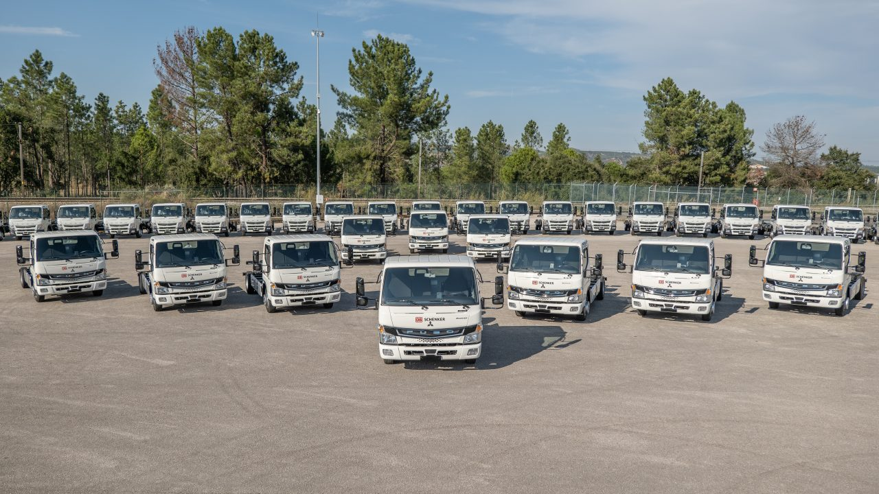 Many e-mobility trucks stand in formation