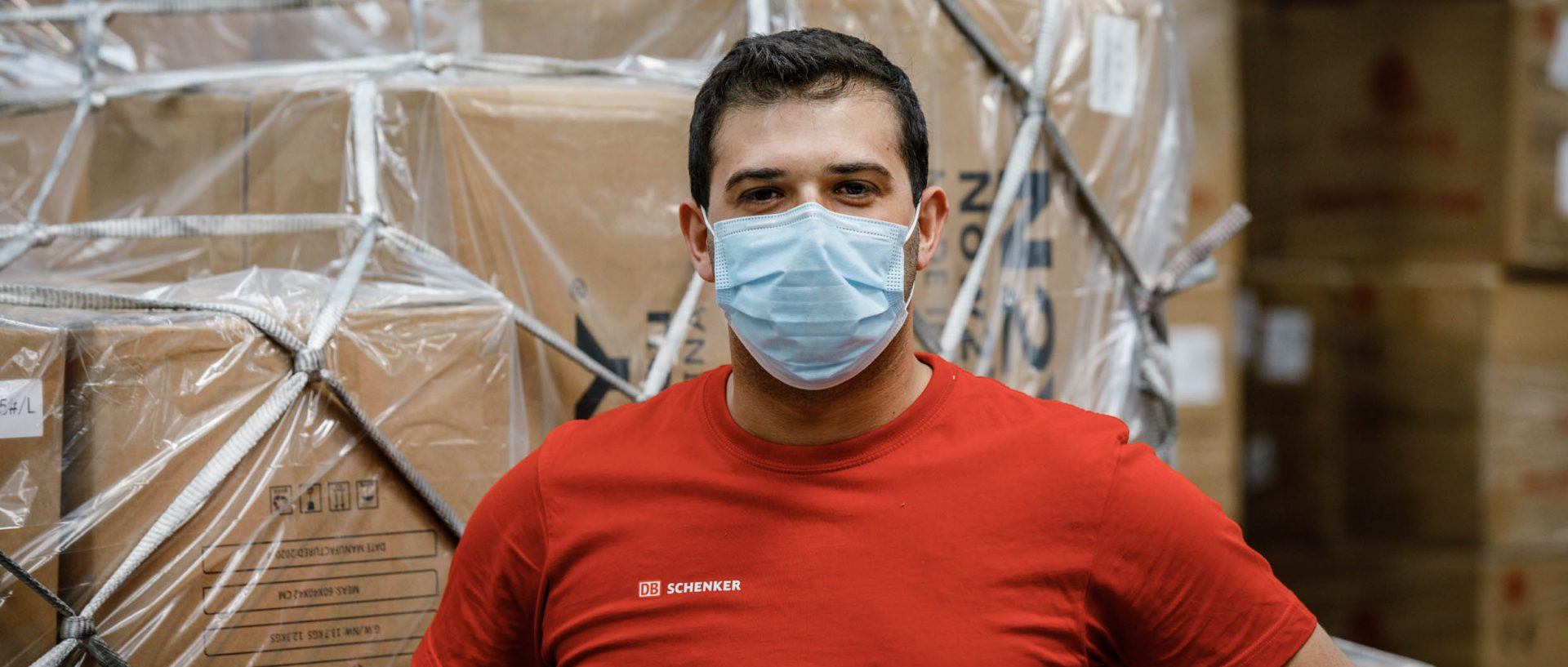 Warehouse employee wearing a mask