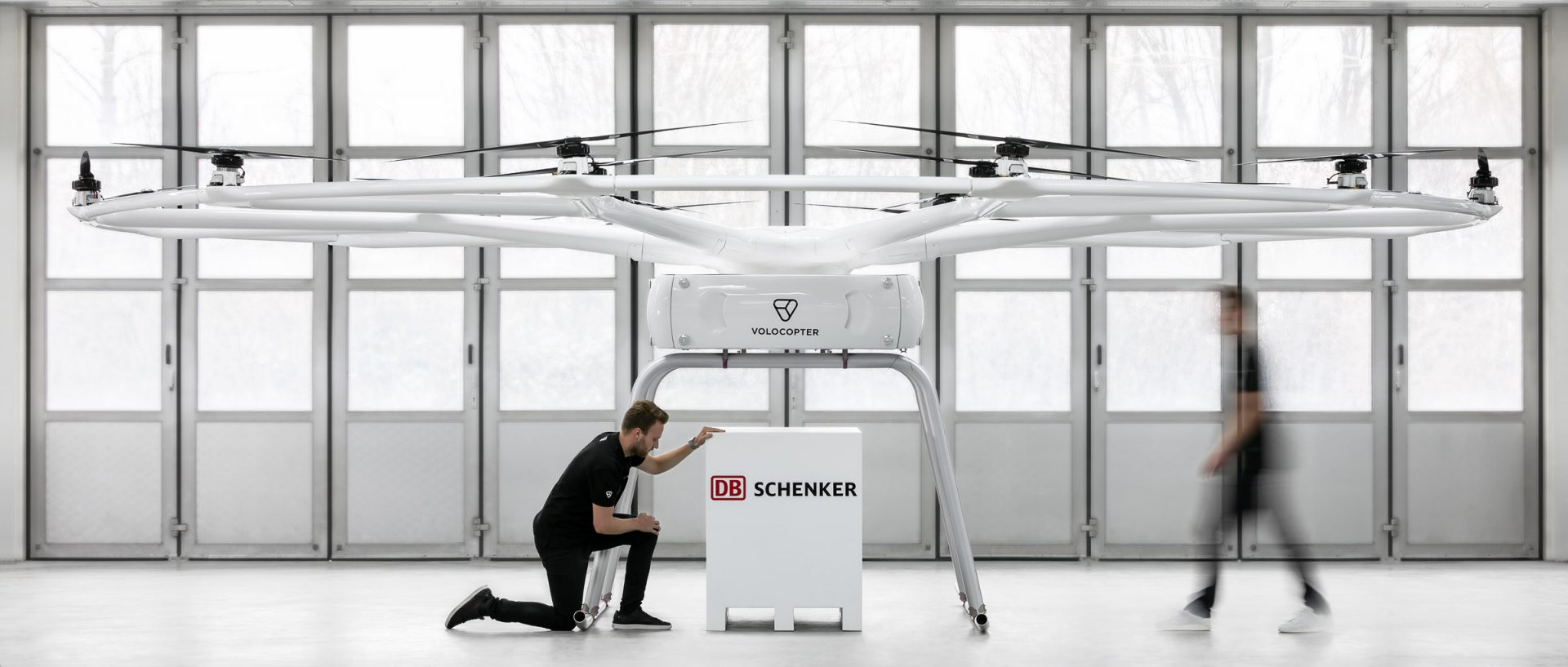 Heavy-lift logistics cargo drone with two people