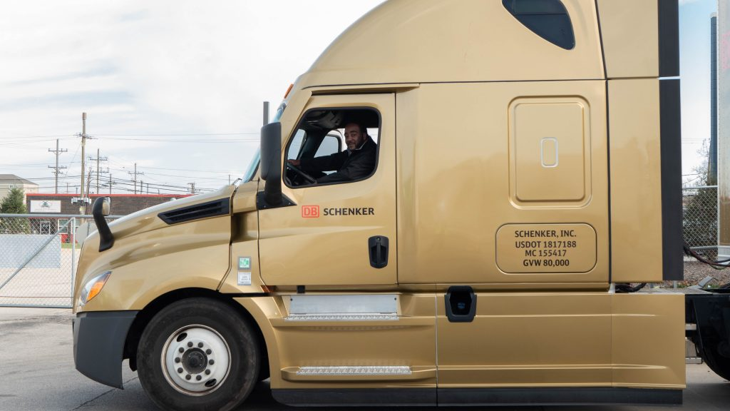 Truck Driver Jerome Johnson is sitting in the Golden Truck of DB Schenker.